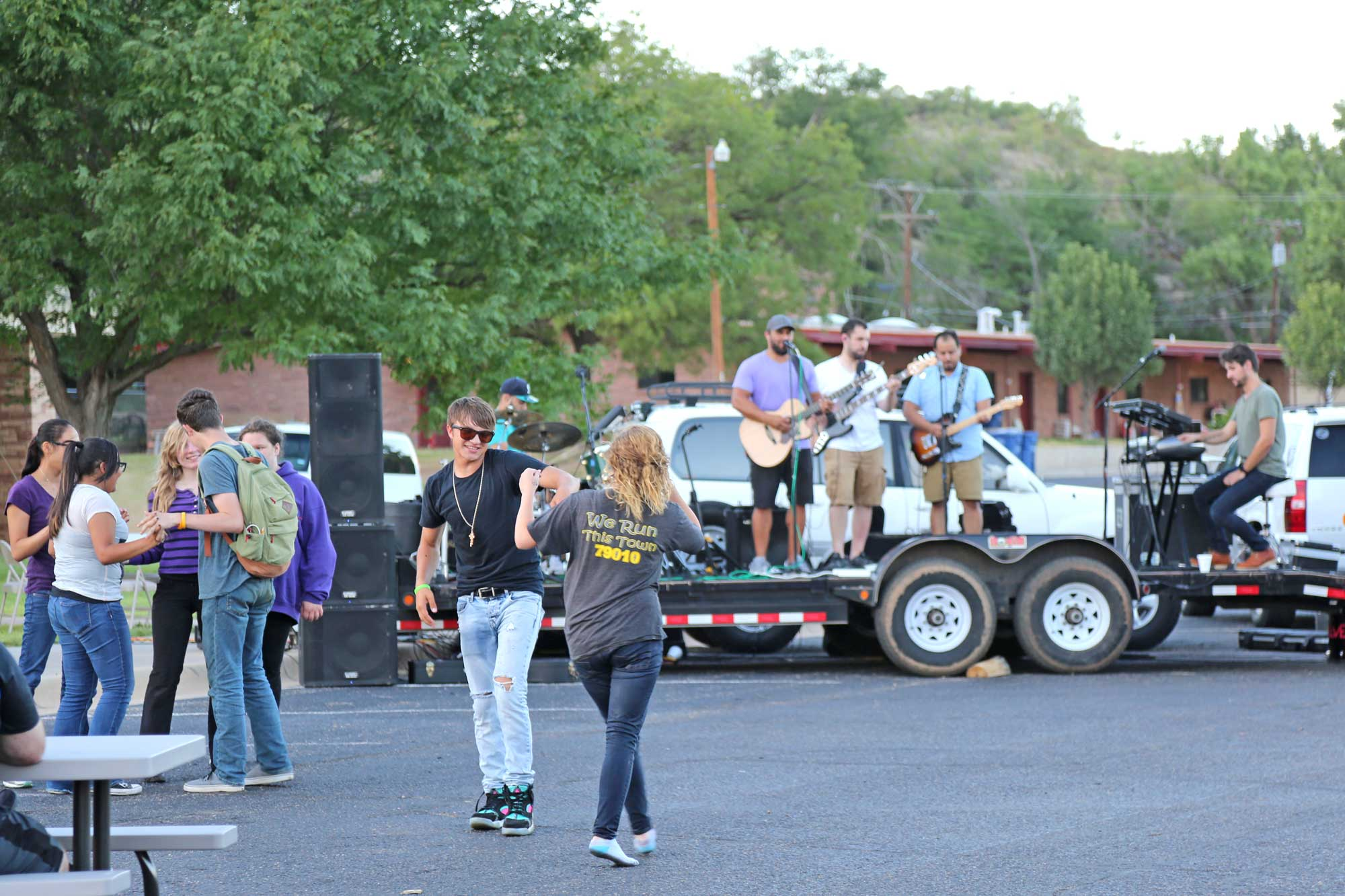 Image 1 of block party band & residents dancing