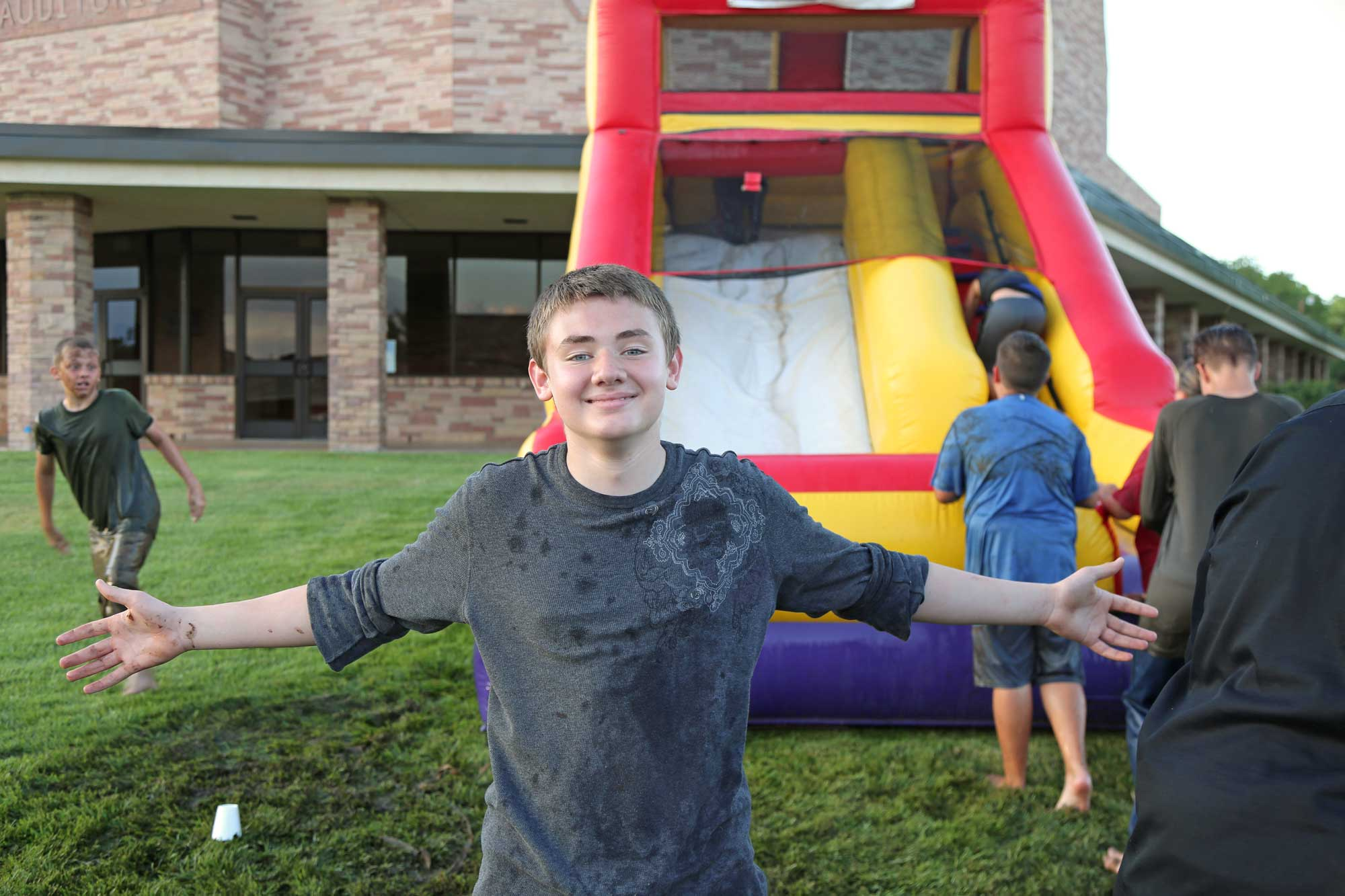 Image 2 of residents using an inflatable water slide