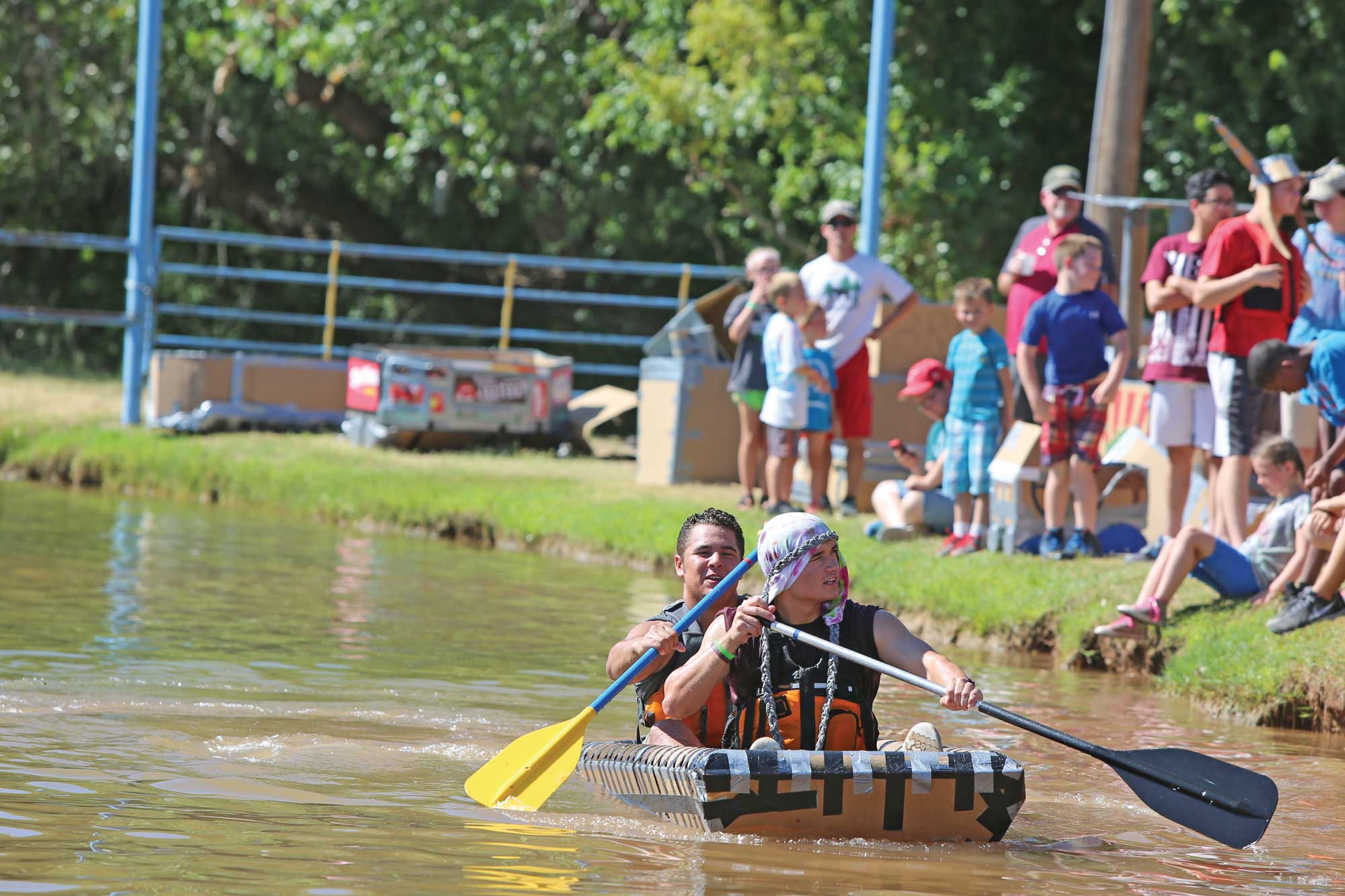 Residents have fun participating in the Boys Ranch cardboard boat races