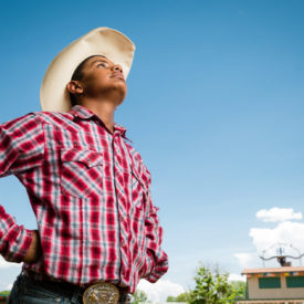 Isaiah enjoys the Boys Ranch Rodeo spotlight