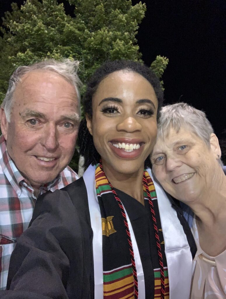 Sierra with Mr. and Mrs. Nation at her graduation from the University of Tulsa